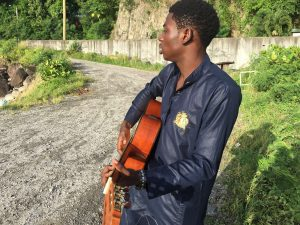 Olugbebga Ayodeji Ebeneze Playing Guitar